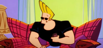 Johnny Bravo sitting in on couch watching TV