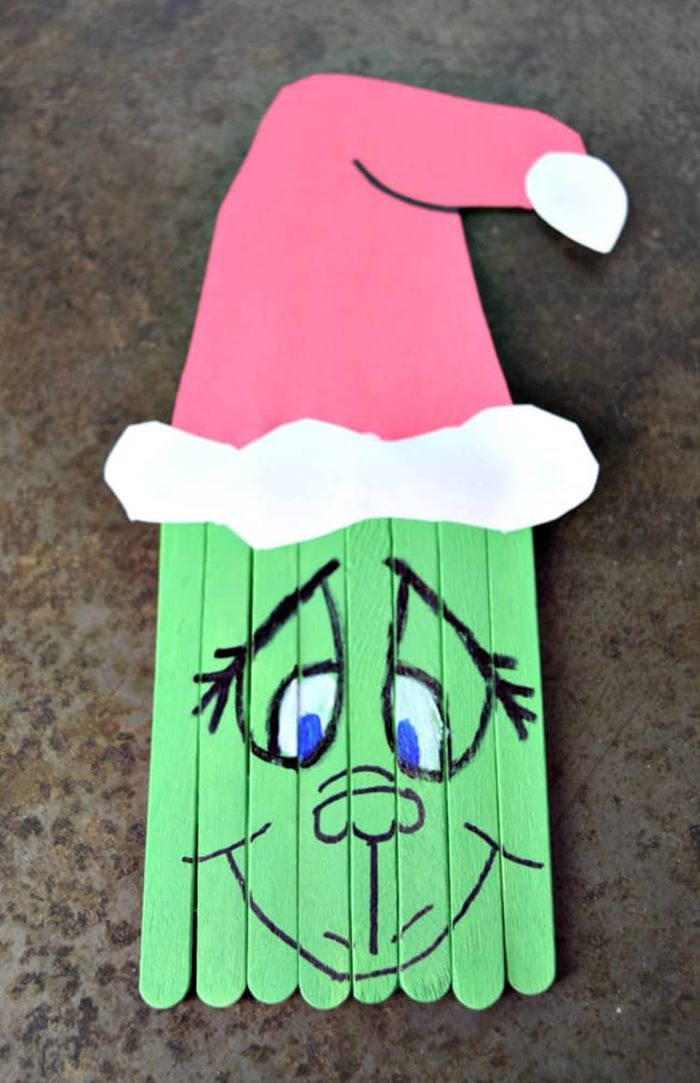 Grinch design on popsicle sticks