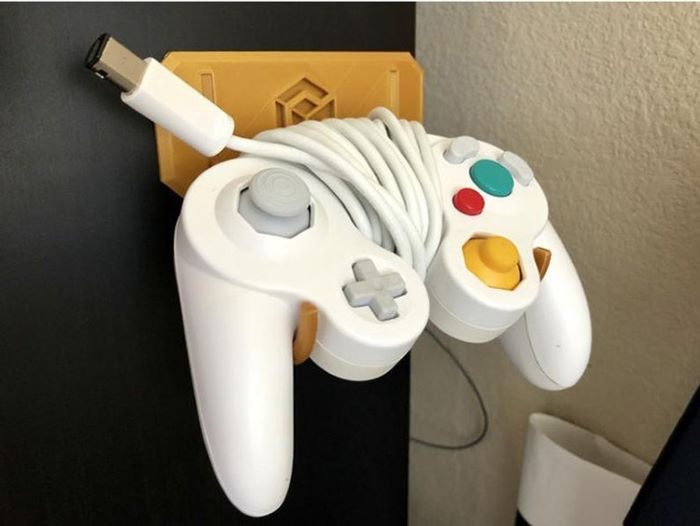 Gamecube wall mounted video controller holder