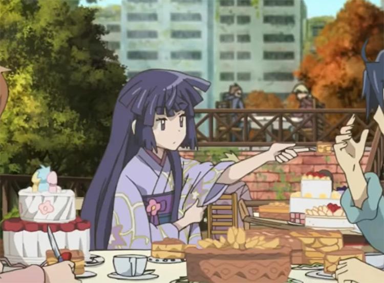 Akatsuki eating in outdoor cafe