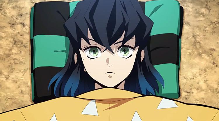 Inosuke Hashibira lying in bed Demon Slayer anime