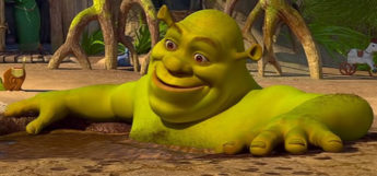 Shrek smiling and soaking in mud bath